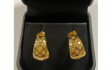 A pair of 18ct gold earrings, set with diamonds (one diamond...