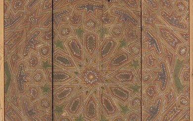 A polychrome wood ceiling panel, Spain or Morocco, circa 18th-19th century, in four panels, of rectangular shape painted in red, blue, green and gold pigments with geometric designs in low relief, in later wood frame, 108.5 x 91cm.