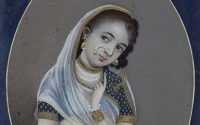 A reverse painting on glass of a young girl in Indian dress, India, early-mid 19th century, shown standing with one arm folded across her waist and the other raised to her face, her head tilted to one side, wearing a diaphanous scarf trimmed with...