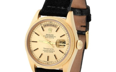 Rolex. Special and Refined Day-Date Automatic Wristwatch in Yellow Gold, Reference 18 078, With Champagne Dial Retailed by Tiffany & Co, Service and Booklet