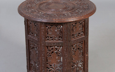TABLE. Carved hardwood, richly decorated, circular top, folding base, China, 20th century.