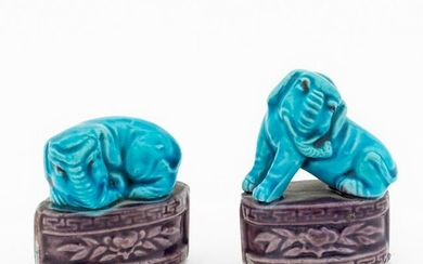 TWO SMALL TURQUOISE & AUBERGINE SEATED ELEPHANTS