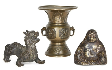 Three Chinese bronzes, late 19th century, with a gu vase cast with birds and archaistic motifs, a Sino-Tibetan figure of a temple lion, and a figure of Buddha, 8cm-12.5cm high (3)