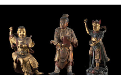 Three carved wood sculptures, partly gilted and painted, of deities (defects and losses) China, late Qing dynasty (h. max 59…Read more