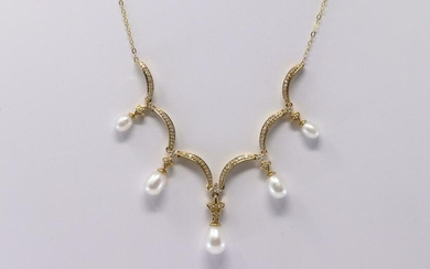 Yellow Gold Pearl Diamond Necklace.