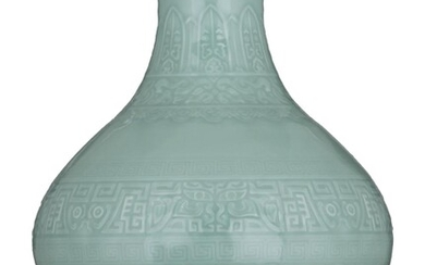 A Chinese archaistic Anhua celadon-glazed bottle vase, with...