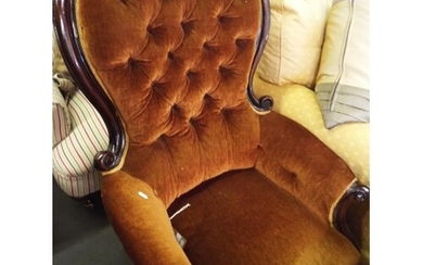 A French walnut button and spoon back chair having carved sc...