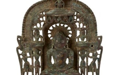 A Jain brass alter piece, Western India, 19th century, cast with a jina seated in meditation on a throne supported by rubbed figures, surrounded by seated or standing figures of tirthankaras, the back inscribed in davanagari script, on an openwork...