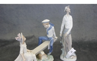 A Lladro figure of Don Quixote standing, 30cm high and a gro...