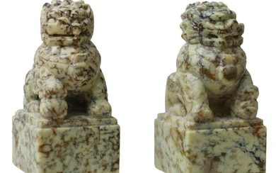 A PAIR OF CHINESE HARD STONE FOO DOG FIGURINES