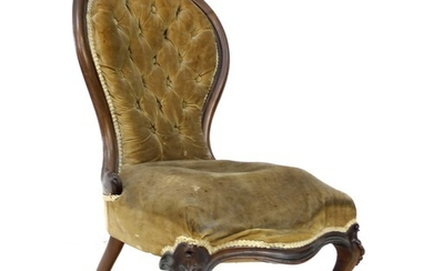 A Victorian button back nursing chair, with walnut carved t...