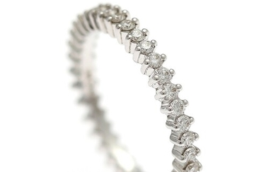 A diamond ring set with numerous brilliant-cut diamonds weighing a total of app. 0.54 ct.,...