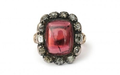 A gold and silver tourmaline and diamond cluster ring, nineteenth century. Gross weight: 7 g.