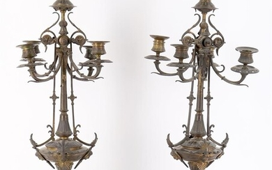 A pair of late 19th century ornate candlestick garnitures