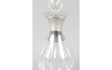 A silver and cut glass decanter and stopper.