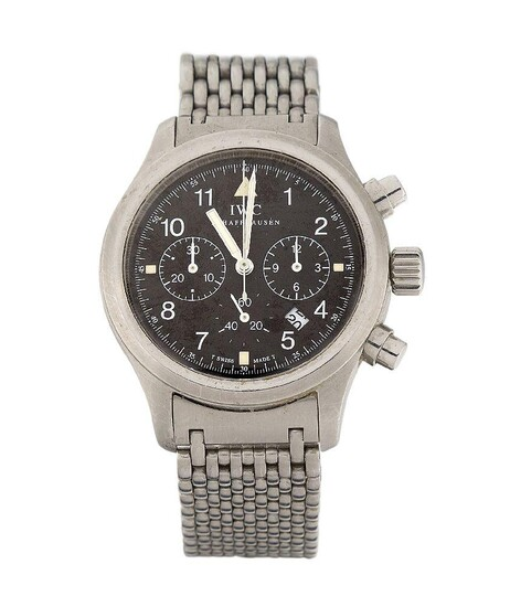 A stainless steel quartz 'Der Fleiger Chronograph' wristwatch by International Watch Company, the black circular dial with Arabic numerals and luminous dot quarters, subsidiary dials for constant seconds, 60 minute and 12 hour registers, and date...