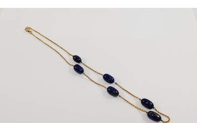 A yellow metal and lapis lazuli necklace, the chain interspe...
