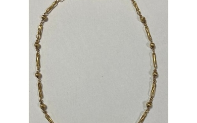 A yellow metal fancy link necklace, clasp stamped 9K
