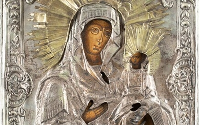 AN ICON SHOWING THE SMOLENSKAYA MOTHER OF GOD WITH OKLAD...