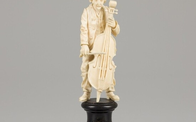 An ivory sculpture of a man with bass, 19th century.