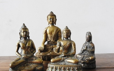 FOUR CAST BRONZE SEATED BUDDHA FIGURES, 20 cm high and three...