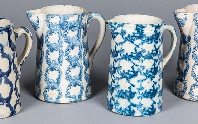 Four blue and white spongeware pitchers, 19th c.