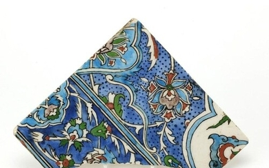 Islamic Iznik pottery tile fragment, hand painted with flowe...