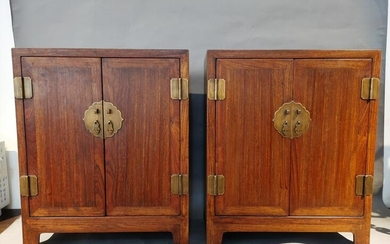 Ming, a pair of Huanghuali cabinets
