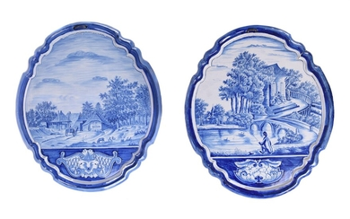 Two similar Dutch Delft blue and white shaped oval wall-plaques