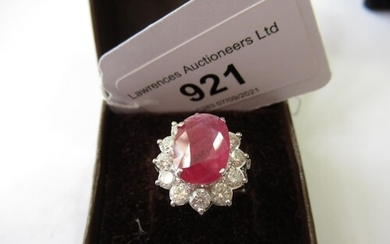 18ct White gold large treated ruby and diamond cluster ring,...