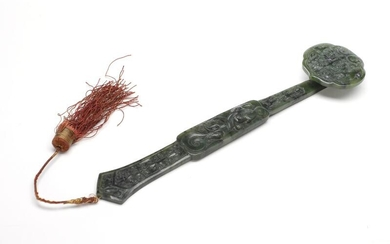 NOT SOLD. A Chinese 20th c. carved spinach green jade ruyi sceptre. L. 28 cm. – Bruun Rasmussen Auctioneers of Fine Art