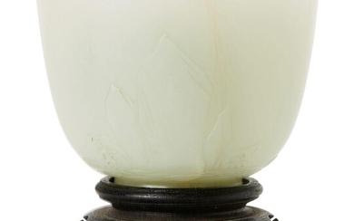 A Chinese celadon jade cup, late Qing dynasty, finely carved...
