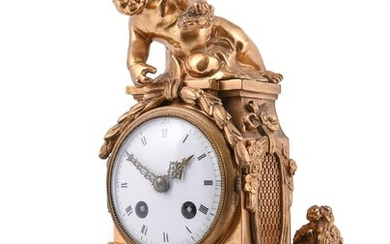 A French gilt metal and marble mounted mantel clock