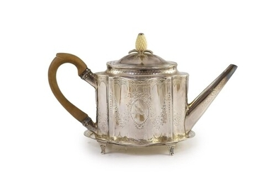 A George III silver bright cut engraved oval teapot and stan...