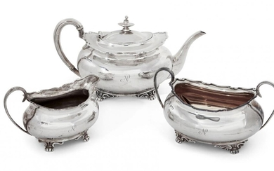 A George V three-piece silver tea set, Sheffield, c.1917 and 1918, Atkin Brothers, of rectangular form with shaped rims to reeded handles, the body of each raised on four bracket feet and engraved with the letter 'N', total weight approx. 35oz (3)