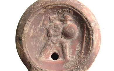 A Roman discus oil lamp depicting a gladiator