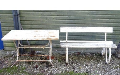 A Victorian garden bench with wrought iron mounts and wooden...