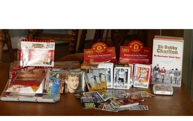 A collection of football trading cards and stickers, primari...