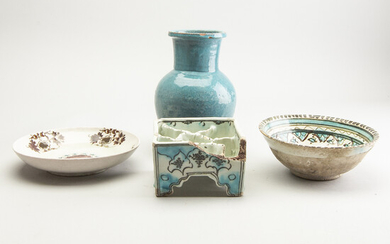 A group of four persian ceramics, 17th/19th Century.