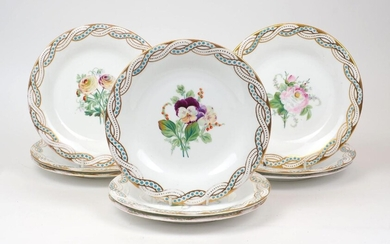 A group of nine Staffordshire plates, 19th Century, hand painted with floral sprays to the centre and gilt and blue raised dot pattern to the rim, unmarked, 23cm diameter (9)
