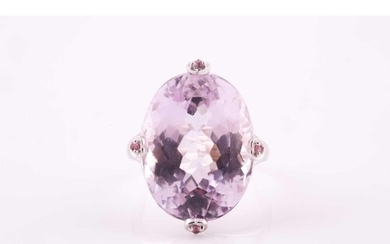 A kunzite and pink sapphire cocktail ring, set with a large ...