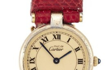 WITHDRAWN A lady's silver gilt quartz wristwatch, by Cartier, the champagne dial with Roman black numerals, blued hands signed Must de Cartier, with cabochon sapphire crown, the strap on case-back also signed Cartier, numbered 189 120489, case...