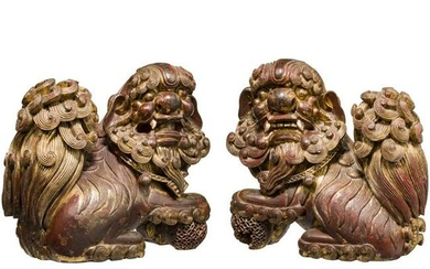 A pair of finely carved Chinese wooden fo-lions
