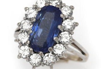 NOT SOLD. A sapphire and diamond ring set with a sapphire weighing app. 3.90 ct. encircled by diamonds, mounted in 18k white gold. Size 51. – Bruun Rasmussen Auctioneers of Fine Art