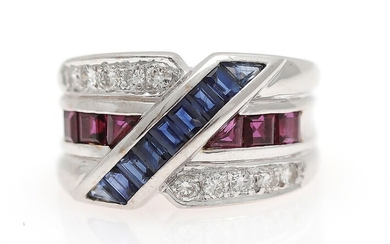 A sapphire, ruby and diamond ring set with numerous sapphires, rubies and diamonds, mounted in...