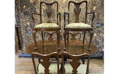 A walnut table, and six matching Queen Anne style dining cha...