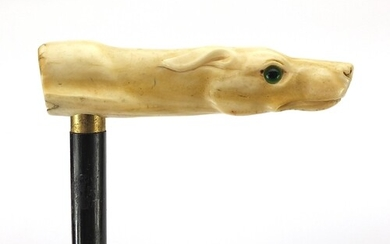 Ebony walking stick with carved ivory pommel in the form of ...