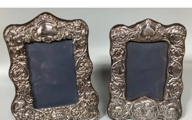 Two various ornate silver photo frames embossed with panels ...