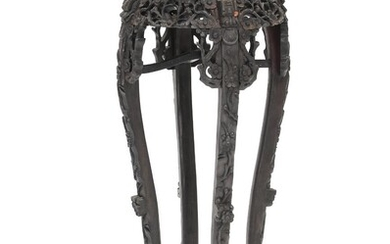NOT SOLD. A Chinese C. 1900 dark polished hardwood pedestal, richly carved with flowers and foliage. H. 91. Diam. 35 cm. – Bruun Rasmussen Auctioneers of Fine Art