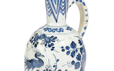 A DELFT POTTERY BLUE AND WHITE JUG OR EWER